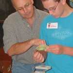 SOU Professor Doug Chapman assists Phoenix High School student Andrew Vargas during the 2010 forensics lab