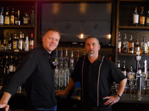 Peter Bolton (left) owns the Playwright, a new pub on A Street in Ashland. Christopher Wells (right) tends bar.