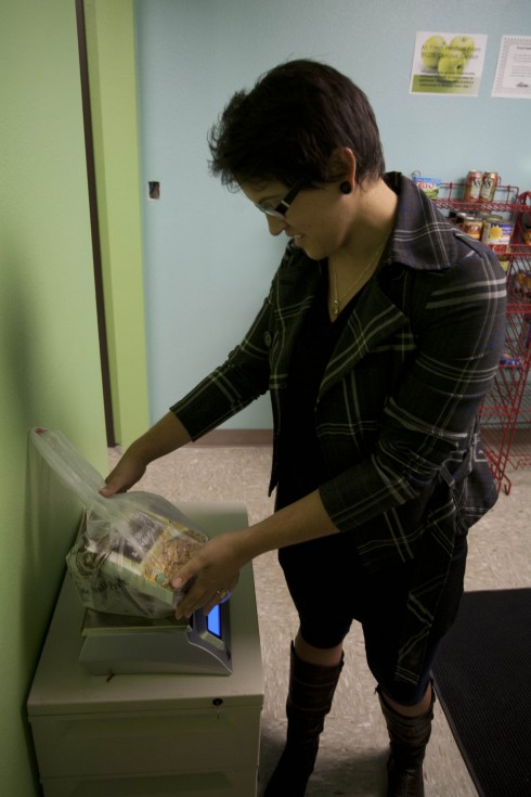 Sophia Mantheakis (Hunger and Homelessness Alleviation Coordinator) weighs a bag of food for a student in the SOU Food Pantry in the lower level of the Stevenson Union.