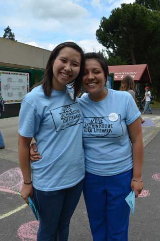 Jazmin Roque and Torii Uyehara posing for a picture while promoting their campaign. (Karoline Curcin/The Siskiyou)