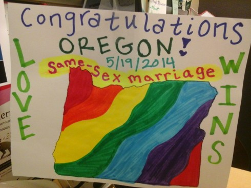 Members of the QRC constructed a sign after hearing the news about marriage equality in Oregon. (Photo cred: The Siskiyou)
