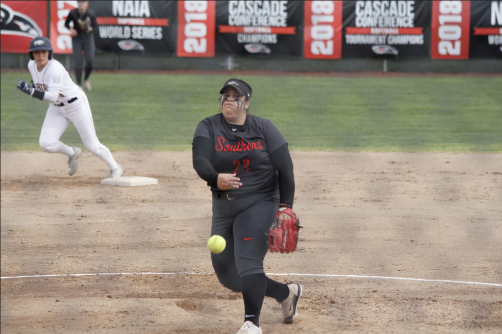 Softball player Gabby Sandoval throws ball