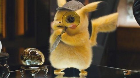 Computer graphic render of the character pikachu in a detective hat holding a magnifying glass.